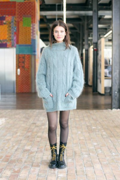 gray, oversized, thick sweater as a mini dress and lace-up boots with a medium calf
