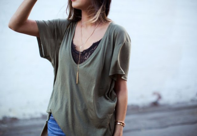 gray oversized low cut t-shirt over black lace top