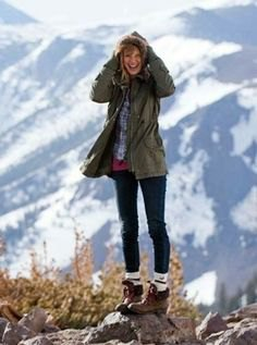 gray parka jacket with dark blue and white checked hiking shirt and boots