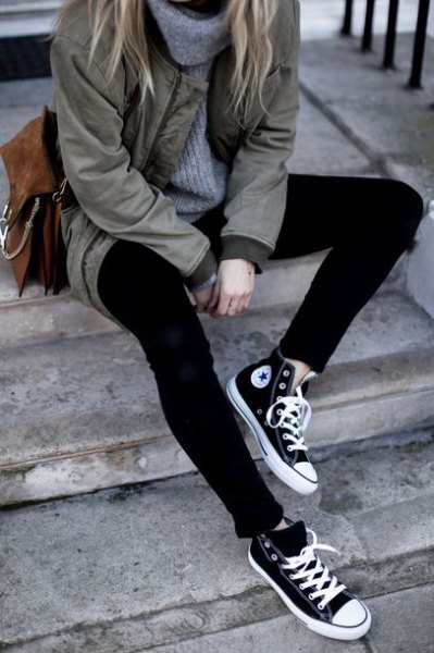 gray parka jacket with turtleneck sweater and black and white canvas shoes