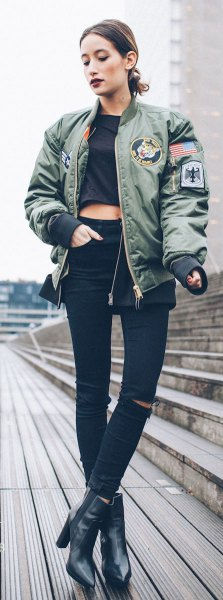 gray patch pilot jacket with black, cropped T-shirt and leather boots