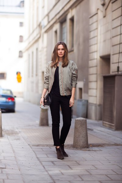 gray pilot jacket with black ankle jeans and suede boots