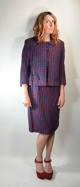 gray checked blazer with a matching knee-length skirt with a straight cut