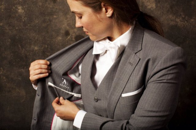 gray checked suit with matching waistcoat and white bow tie