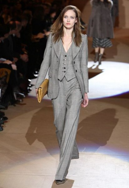 gray checked suit with wide-leg pants and brown leather handbag
