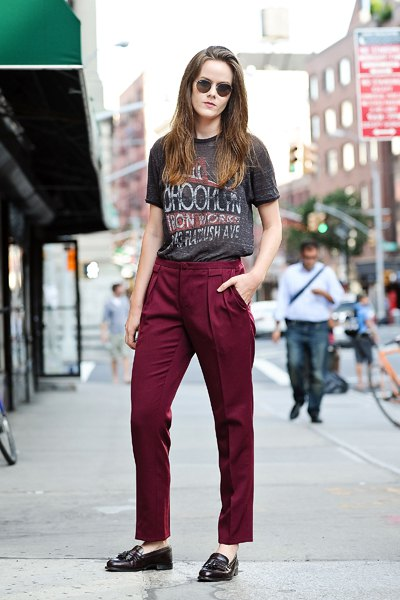 gray printed T-shirt with burgundy red trousers with straight legs and matching slippers