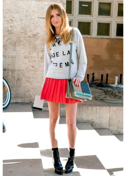 gray printed sweatshirt with round neckline and orange mini skirt