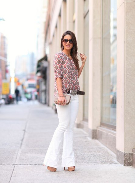 gray printed blouse with half sleeves and white jeans with a bell bottom