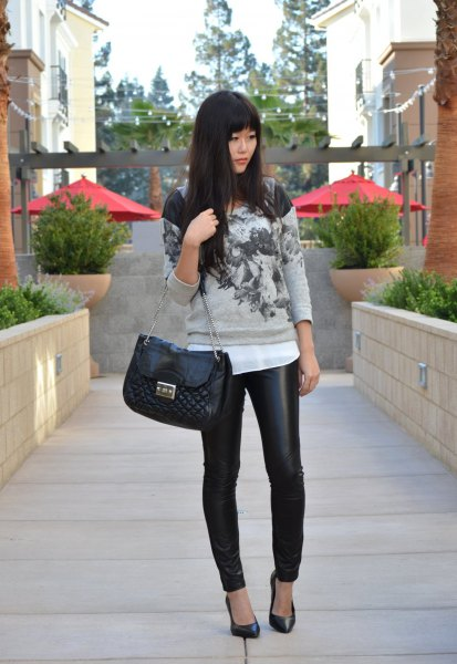 gray printed sweater with white chiffon blouse and quilted wallet made of black leather