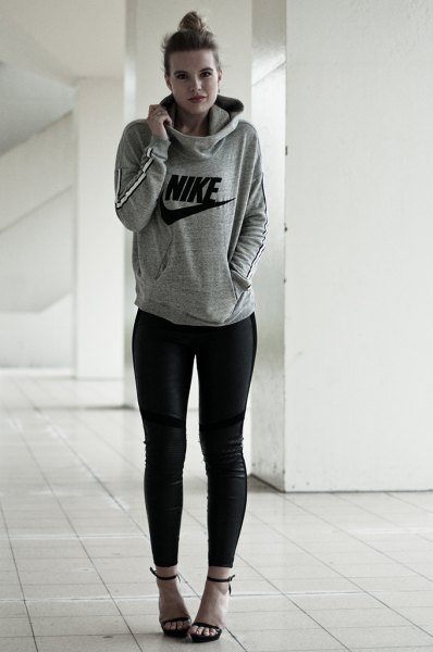 gray pullover hoodie with black skinny jeans and open toe heels