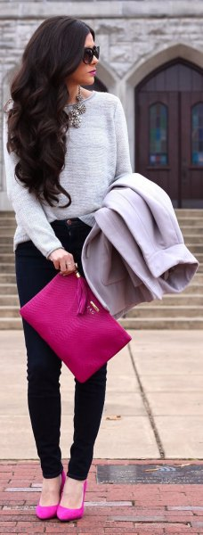 gray sweater with pink clutch bag