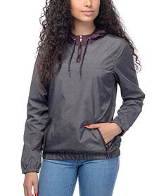 gray pullover windbreaker with blue slim fit jeans