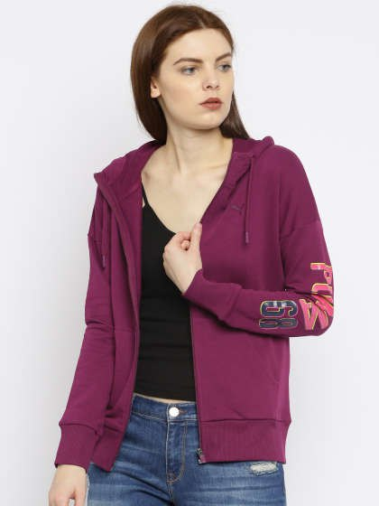gray Puma sports jacket with black tank top with scoop neckline