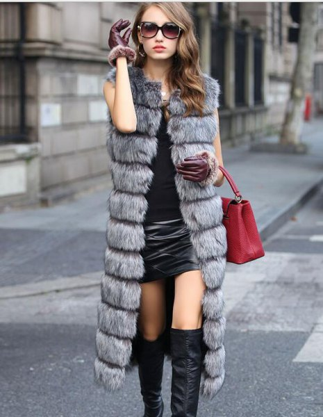gray quilted faux fur vest with black mini leather skirt