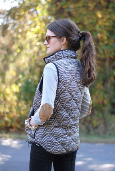 gray quilted long down vest with white top with patch elbows