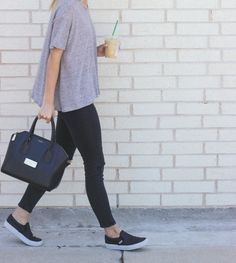 gray relaxed fit t-shirt with black slim fit jeans and sneakers