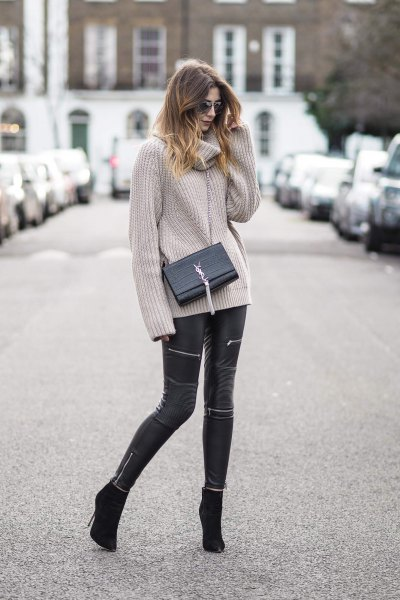 gray, ribbed sweater with waterfall neckline and black leather pants