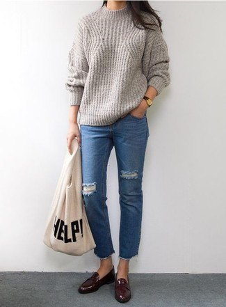 gray, ribbed sweater with round neckline, blue cut jeans and burgundy-colored slippers