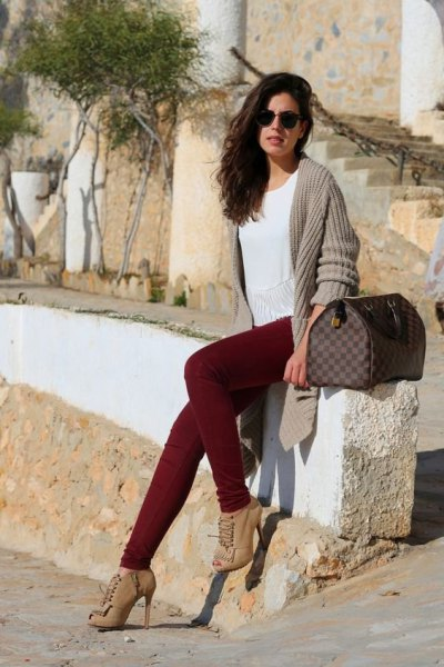 gray, ribbed longline cardigan with maroon jeans and boots with heel