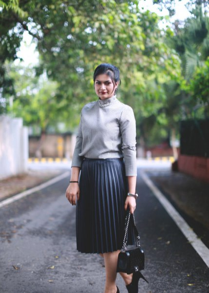 gray, ribbed mock-neck sweater with black midi skirt