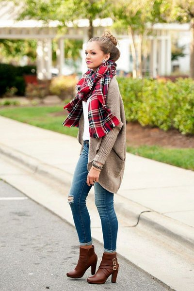 gray ribbed cardigan with a red plaid scarf and ankle-high boots