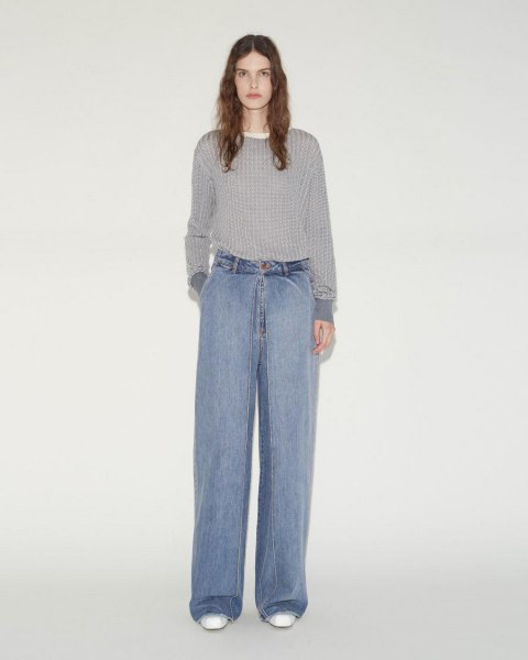 gray ribbed sweater with light blue pleated wide-leg jeans