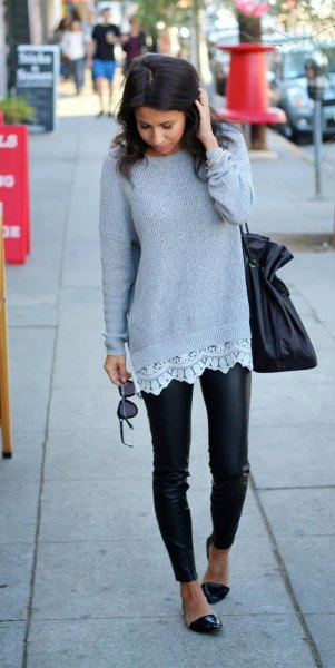 gray ribbed sweater with white tunic blouse and leather tights