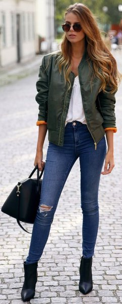 gray satin bomber jacket with white blouse and blue skinny jeans
