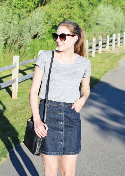 gray t-shirt with scoop neckline and dark blue denim mini skirt with button placket