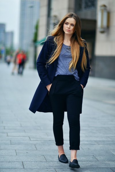 gray t-shirt with scoop neckline, dark blue long wool coat and black leather loafers