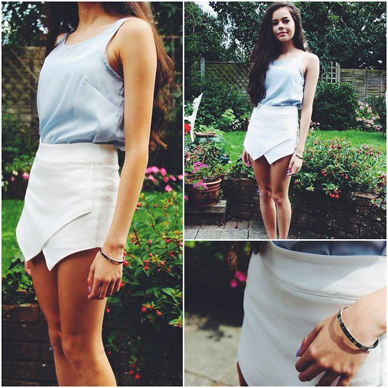 gray tank top with scoop neckline and white mini skirt