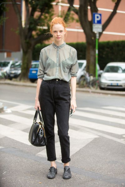 gray, semi-transparent shirt with buttons and black mom jeans with cuffs