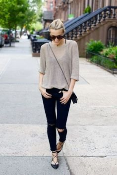 gray, semi-transparent sweater with black jeans and strappy flats