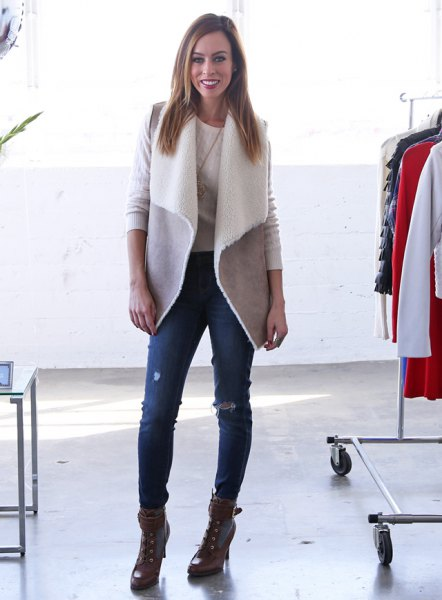 gray lambskin vest with torn skinny jeans and combat boots