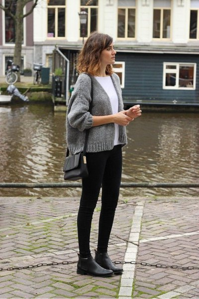 gray, short knitted cardigan with a round neckline and black skinny jeans