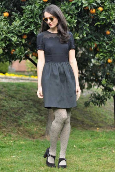 gray short-sleeved blouse with a relaxed knee-length skirt