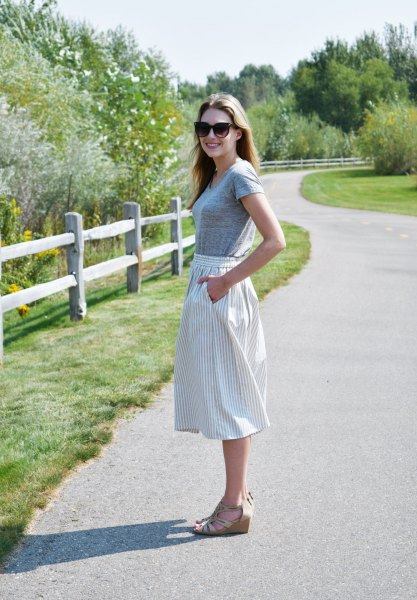 gray short-sleeved T-shirt with vertically striped midi skirt