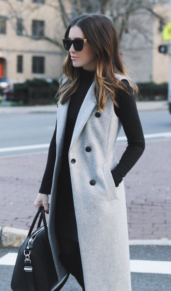 gray sleeveless double-breasted wool coat with black shift dress