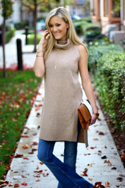 gray sleeveless tunic top with double slit and blue flared jeans