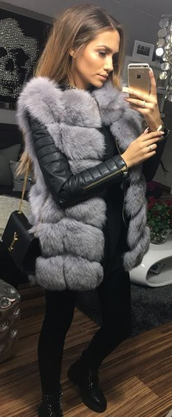 gray sleeveless bubble coat made of faux fur with a black leather jacket
