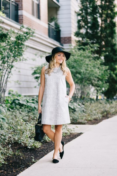 gray sleeveless mini dress with black floppy hat and flats