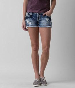 gray sleeveless top with blue denim shorts