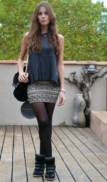 gray sleeveless top with tribal printed mini skirt and stockings