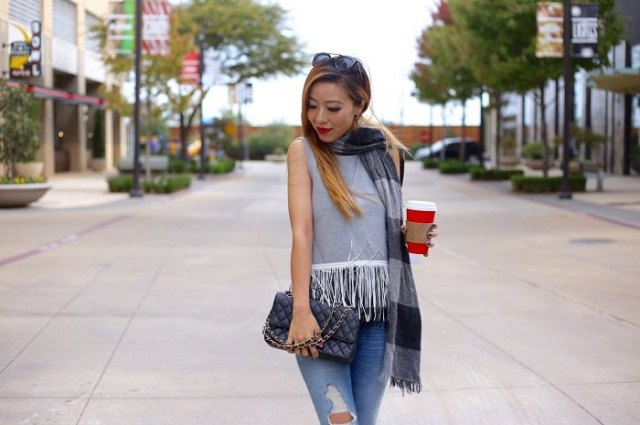 gray sleeveless top with white fringes