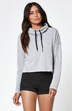 gray, slightly shortened hoodie with black mini-shorts