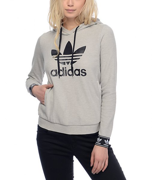 gray sports hoodie with black slim fit jeans