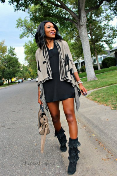 gray cardigan with black mini dress and autumn boots with fringes in the middle of the calf
