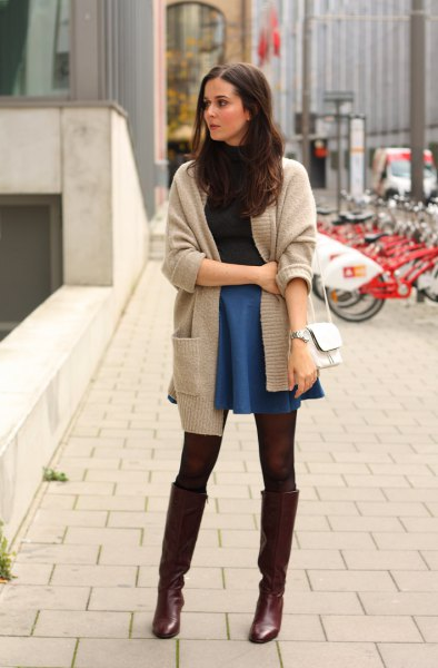gray cardigan with blue jeans skater mini skirt and black high boots