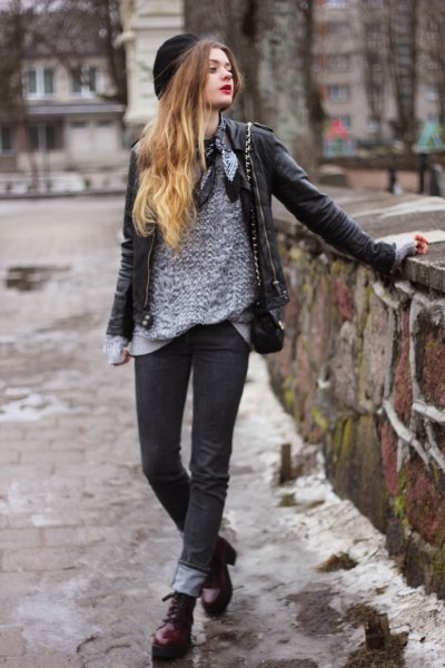 gray sweater with black leather jacket and cuffed jeans