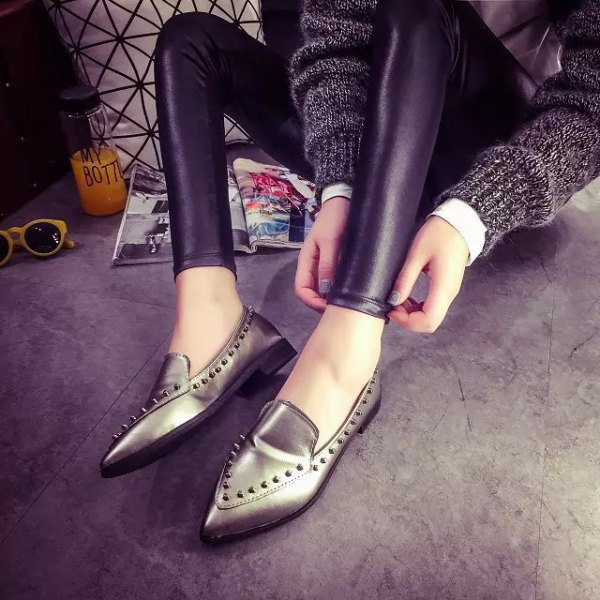 gray sweater with leather gaiters and metallic wingtip shoes